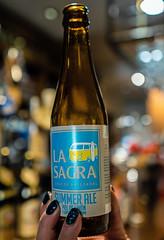 Bottle of La Sagra Summer Ale  - Spainish Beer Made with Lemons ( Beer & Travels - Valencia)  (Olympus OM-D EM5-II & M.Zuiko 17mm f1.2 Pro Prime) (1 of 1) (markdbaynham) Tags: valencia spain city em5 olympus street espana metropolis beer cerveza birra spainishbeer beerandtravels bar bottle lasagra lasagrasummerale craftbeer 17mm f12 mzd zd mz mzuiko zuikolic blur em5ii csc mirrorless m43 m43rd micro43 micro43rd olympusm43 summerale em5markii cityscape citylife em5mark2 olympistas spanish fixedlens