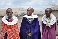 The Maasai Women (The Spirit of the World ( On and Off)) Tags: tanzania eastafrica africa tribe nomadic huts skyclouds elegant dress locals jewelry necklaces beads earrings portraits norhterntanzania mudhuts village