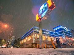 Indoor VS Outdoor (Brian D' Rozario) Tags: brian19869 briandrozario nikon d750 tokina 1116mm outdoor outdoors snow snowfall snowing weather climate temperature inn food indoor indoors night urban city cold winter neon brightlight life street streets streetphotography umbrella storm stormy billlboard nyc newyork newyorkcity citylife busy