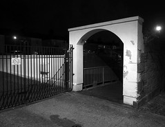untitled (chrisinplymouth) Tags: archway gate night plymouth devon england uk cw69x diagx desx black white xg fence wall corner monochrome
