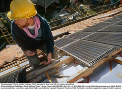 "Fitting Solar Panels 05 (hoffman) Tags: alternative architecture british britishisles builder building conservation construction ec eec efficiency electrical electricity employment engineer england english environmental eu europe europeanunion fitting fixing generating generation greatbritain hardhat helmet high horizontal house housing labor light male men panel photovoltaic power pv renewable renewableenergy roof science solar sun sunshine sustainable technology tiles uk unitedkingdom wires wood work worker working davidhoffman wwwhoffmanphotoscom davidhoffmanphotolibrary socialissues reportage stockphotos""stock photostock photography"" stockphotographs""documentarywwwhoffmanphotoscom copyright"