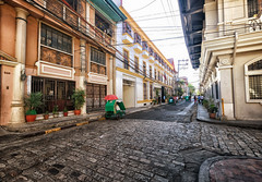 Inside the Walled City in Manila, Philippines (` Toshio ') Tags: toshio manila philippines intramuros spanish asia filipino street architecture cobblestone bike city history fujixt2 xt2 people bicycle powerlines
