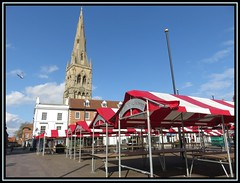 Newark Market Place (M E For Bees (Was Margaret Edge The Bee Girl)) Tags: newark nottinghamshire market red white covers spire stmarymagdelene canon church christianity anglican churchofengland stalls outdoors sun sky blue spring empty stone buildings