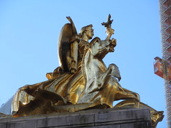 2019 Victory Statue USS Maine Monument - Gold Leaf Gilded 2288 (Brechtbug) Tags: uss maine monument 1913 beaux arts commemorate controversial sinking battleship 1898 the ship has sculpted representations mythological figures victory peace courage fortitude justice central park entrance nyc 02192019 new york city arms wrapping around rock statue sculpture february 2019 columbus circle