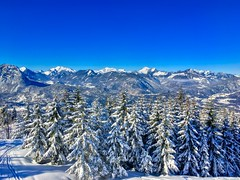Winter mountain view of Kaiser mountains near Kufstein, Tyrol, Austria (UweBKK (α 77 on )) Tags: winter snow ice cold blue sky mountains alpine alps tree forest view scene scenery scenic landscape kaiser kaisergebirge kufstein tyrol tirol austria europe europa iphone österreich