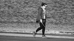 Seaside Strolling 04 (byronv2) Tags: edinburgh edimbourg scotland sea seaside coast coastal peoplewatching candid street walking water river rnbforth firthofforth riverforth forth portobello blackandwhite blackwhite bw monochrome woman