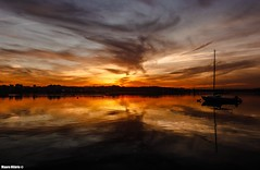 Sundown (Mauro Hilário) Tags: water waterscape reflection boat bay river sunset sky scenery portugal seixal beautiful magical symmetry silhouette clouds