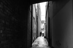 Passage Way (Bury Gardener) Tags: burystedmunds bw blackandwhite britain monochrome mono england eastanglia uk people peoplewatching folks nikond7200 nikon suffolk streetphotography street streetcandids snaps strangers candid candids 2019 cornhill