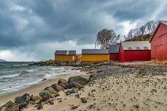 Naust på Osnes (Oddbjørn Strand) Tags: boathouses shore beach sea ocean rocks clouds coast coastal colours