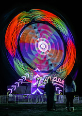 zipper rainbow (pbo31) Tags: bayarea eastbay alamedacounty california nikon d810 color night dark black march 2019 boury pbo31 oakland butleramusements fair traveling carnival spinning lightstream motion ride midway red