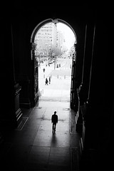 DSC07432 (lucymagoo_images) Tags: philadelphia philly center city urban sony rx100 cityhall northbroad street silhouette pedestrian bw doorway arch walking sidewalk solitary alone grainy contrast blackandwhite monochrome darkness light