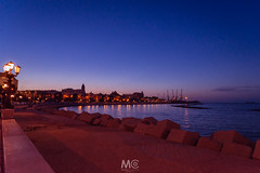 Promenade blue hour at Bari (Mariano Colombotto) Tags: bari apulia puglia italy italia promenade coast coastline sea seascape water nikon travel bluehour lamppost city cityscape lights sky tones