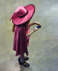 Take That Dorothy (Steve Taylor (Photography)) Tags: witch texting mobile phone hat stripedsocks black pink child kid girl newzealand nz southisland canterbury christchurch armageddonexpo addington costume