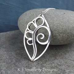 Petals and Swirl Leaf Sterling Silver Pendant (KSJewelleryDesigns) Tags: metalwork flower pendant necklace jewellery jewelry handmade brightsilver shine sterlingsilver silverjewellery handcrafted silver silverwire metal hammered shiny polished bright soldered soldering brushed flowers petals sawing piercing silversmith silversmithing daisy daisies blooms blossom gemstone cabochon flowerpendant swirlblossom texture stamens organic wirework stonesetting swirl leaf
