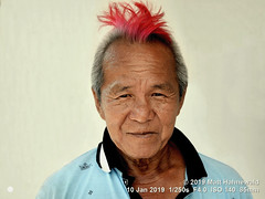 2013-11c Targeting Asia's Bold Menfolk (90) 2019 (01) (Matt Hahnewald) Tags: matthahnewaldphotography facingtheworld people character head face eyes expression lookingatcamera hair hairstyle dyedhair pink red stylish punk consent concept humanity living travel culture lifestyle style cultural georgetown penang malaysia asia asian malaysianchinese southeastasian individual oneperson male adult elderly man portraiture physiognomy nikond610 nikkorafs85mmf18g 85mm 4x3ratio resized 1200x900pixels horizontal street portrait closeup headshot fullfaceview outdoor colour posing clarity