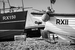 Congested (ShrubMonkey (Julian Heritage)) Tags: hastings thestade beach shingle seaside coast coastal shore boats fishingboats nautical stern hull gear eastsussex sunrise southcoast sun light shadows wideangle sky stade boat rx11 rx150 nn736 mono bw bow
