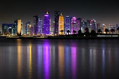 Doha Skyline (Torsten Reimer) Tags: nacht night asia water reflections spiegelungen cityscape langzeitbelichtung bäume trees arabia himmel katar hochhaus sky skyscrapers longexposure skyline qatar reflektionen doha qa