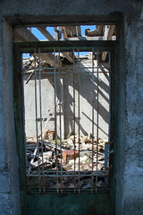 IMG_1850 (libbykimpson) Tags: greece natural disaster shadow light old broken destroyed abandoned contrast building architecture frame decay worn rust