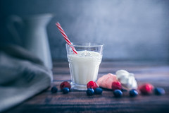 Glass of milk (Ro Cafe) Tags: ddproject52 fruits lensbaby lunchtime selectivefocus sol45 sonya7iii stilllife berries blur glass jug meringues milk week10 textured naturallight