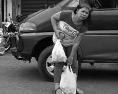 College Girl (Beegee49) Tags: street woman filipina carrying shopping heavy blackandwhite monochrome happy planet luminar sony a6000 bw bacolod city philippines asia