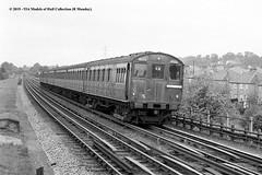 24/07/1957 - North Harrow. (53A Models) Tags: londontransport metropolitanline tstock emu electric passenger underground northharrow london train railway locomotive railroad