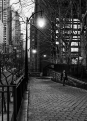 Looking for the Heart of Friday Night (Kenneth Laurence Neal) Tags: newyorkcity urban street streetphotography cities people evening streetlamp lowlight blackandwhite monochrome monotone noir canonrebelt6i canon newyork