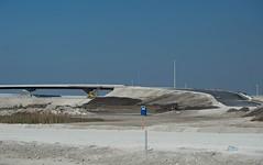 Land Barren (ACEZandEIGHTZ) Tags: nikon d3200 construction highway dirt overpass road white portapotty gravel landscape expressway