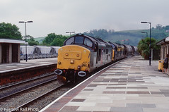 Better Late Than Never (Kernow Rail Phots) Tags: kernow cornwall lostwithiel 37407 37153 class37 37s 6m72 1655 ttho stblazey cliffevale saturday 15th may 1999 1990s 1551999 transrail dutch young lady people train freight trains railway railroad railways station lamps signals trees englishelectric tractors chinaclay clay cdas platforms buildings human interest engineers livery sectorisation bush bushes