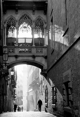 Carrer del Bisbe (Douguerreotype) Tags: people monochrome bridge light barcelona blackandwhite sunrise buildings catalunya spain mono street architecture city urban bw