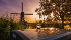 Sunset, reflections and lensball at Kinderdijk (Erik Graumans NL) Tags: windmill molen kinderdijk sunset lensball reflection colorful holland netherlands fuji xt20 molens mills reflectie