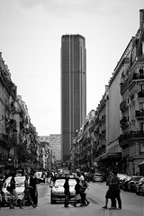 The monolith (R o m a n H) Tags: bw blackandwhite tower city street crossing road pedestrians
