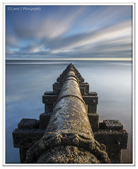 ABC_5388 (Lynne J Photography) Tags: northumberland coast seascapes sunrise water longexposure groynes outfallpipe clouds mono blackwhite pier cambois blyth rocks seatonsluice lighthouse pastel colors dawn light