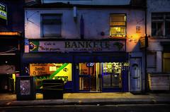 With Brazilian Ingredient (Dimmilan) Tags: uk england london aldgate urban building night nightlight restaurant cafe street door windows