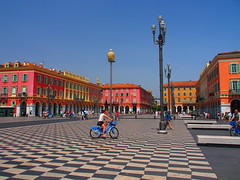 Nice - place Massena (Alpes Maritimes, F) (pietro68bleu) Tags: place massena ville france damier nice square city cityscape people architecture beautiful building biker bike vue view street lamp child arch pattern red orange yellow