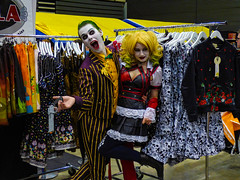 A Bit of a Joker (Steve Taylor (Photography)) Tags: jumper wig costume skull revolver gun joker armageddonexpo fashion colourful red black yellow white green man woman lady stripes