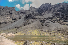 Coire Lagan looking up to Sgùrr Alasdair. (Scotland by NJC.) Tags: lakes lochs reservoirs waters meres tarns ponds pool lagoon lago 湖 jezero sø meer järvi lac see λίμνη 호수 innsjø mountains hills highlands peaks fells massif pinnacle ben munro heights جَبَلٌ montanha 山 planina hora bjerg berg montaña remote distant isolated inaccessible farflung secluded outoftheway faraway outlying wild unspoiled natural remoto 遥远的 udaljen odlehlý fjern ver kaukainen lointain isleofskye blackcuillin scotland rugged scree