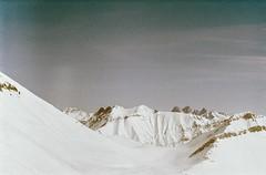 The Other Earth (Tamar Burduli) Tags: tamarburduli 35mm nature landscape mountains mountainscape analog film winter snow travel caucasus georgia gudauri sky skyscape clouds surreal psychedelic zenit kodak