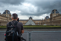 Photographer's View of the Louvre (shapeshift) Tags: davidpham davidphamsf documentary europe france louvre museum paris people photographer pyramid rainclouds shapeshift street streetphotography travel