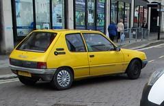 1991 Peugeot 205 1.1 Junior (occama) Tags: j160lrl 1991 peugeot 205 junior yellow old car cornwall uk cornish bangernomics french