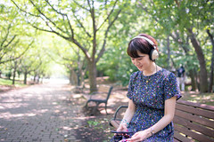 Young woman listening to music over headphones at green forest (Apricot Cafe) Tags: img104442 asia asianandindianethnicities japan japaneseethnicity kasairinkaipark millennialgeneration tamronsp35mmf18divcusdmodelf012 tokyojapan beautifulwoman bench bright capitalcities casualclothing charming colorimage day enjoyment forest happiness headphones leisureactivity lifestyles listening music oneyoungwomanonly onlywomen outdoors people photography publicpark realpeople relaxing resting sitting smartphone smiling summer universitystudent walkway