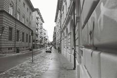 Rimini (goodfella2459) Tags: nikonf4 afnikkor24mmf28dlens fujifilmneopanacros100 35mm blackandwhite film analog rimini italy streets buildings road car pedestrians bwfp manilovefilm