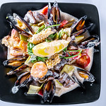 Delicious seafood with sauce thumbnail
