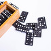 Close up of domino set with wooden box on white background