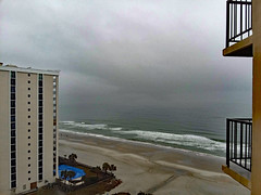 Overcast Skies Above The Ocean. (dccradio) Tags: myrtlebeach sc southcarolina horrycounty hilton hotel lodging motel resort hiltonresort outdoor outdoors outside february monday mondayafternoon goodafternoon afternoon travel workingvacation water waves ocean atlantic atlanticocean beach shore city building architecture resorts hotels tallbuildings skyscraper sand bodyofwater samsung galaxy smj727v j7v cellphone cellphonepicture