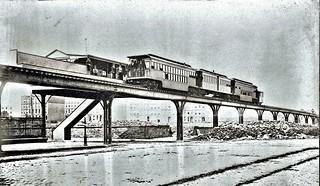 Ninth Avenue El, Manhattan, at 59th Street and 60th Street, 1876.