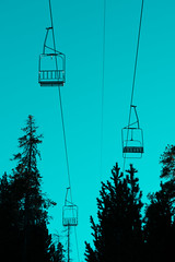 Gone. (alterjorch) Tags: sky blue mountain tree light travel forest snow rackets ice silhouette chair chairlift