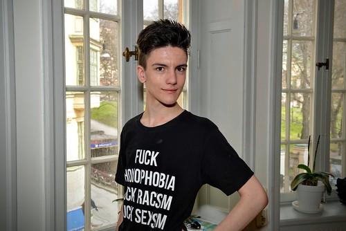 Guy Wearing Shirt Promoting Anti-Racism and Anti-Homophobia