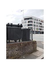 fence (chrisinplymouth) Tags: corner fence railings bin millbay plymouth devon england uk city cw69x wall street road diagx desx urbio xg diagonal