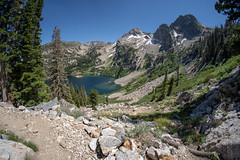 Fisheye view of Alpine Lake along the Sawtooth Lake and Iron Creek Trail in Idaho on a sunny summer day (m01229) Tags: sunny color pine peaceful nature reflection day beauty lake recreation snow trees summer tree peak scenic outdoors america stanley tranquil landscape sawtoothnationalforest fisheye sky range sawtooths reflections sawtooth landscapes mountains alpine clouds sunrise daytime blue stanleylake northamerica adventure travel forest sawtoothmountains american water green idaho outdoor wilderness mountain