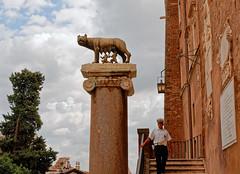 Rome / Capitoline Wolf and his guardian (Pantchoa) Tags: rome italie europe louve capitole colonne pin arbre nuages policier statue sculpture escalier personne lanterne louvecapitoline romulus remus